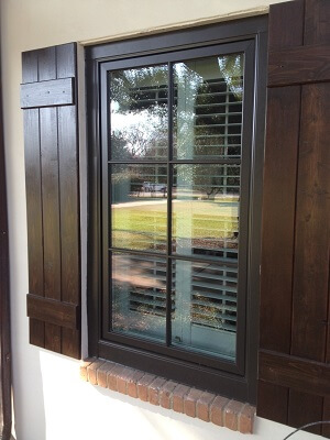 after image of dallas home with new wood casement windows and wood entry door