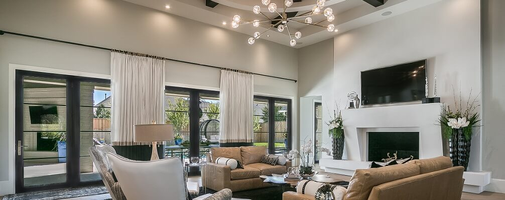 living room view of dallas new construction home with wood casement windows