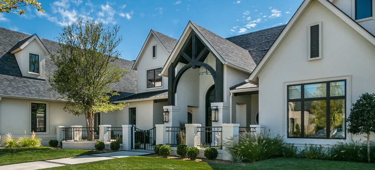 outside image of dallas new construction home with wood casement windows