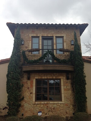 texas home gets new wood windows and hinged patio doors front view