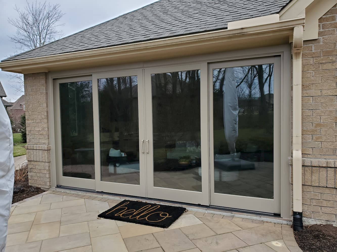 After photo of four-panel sliding glass doors