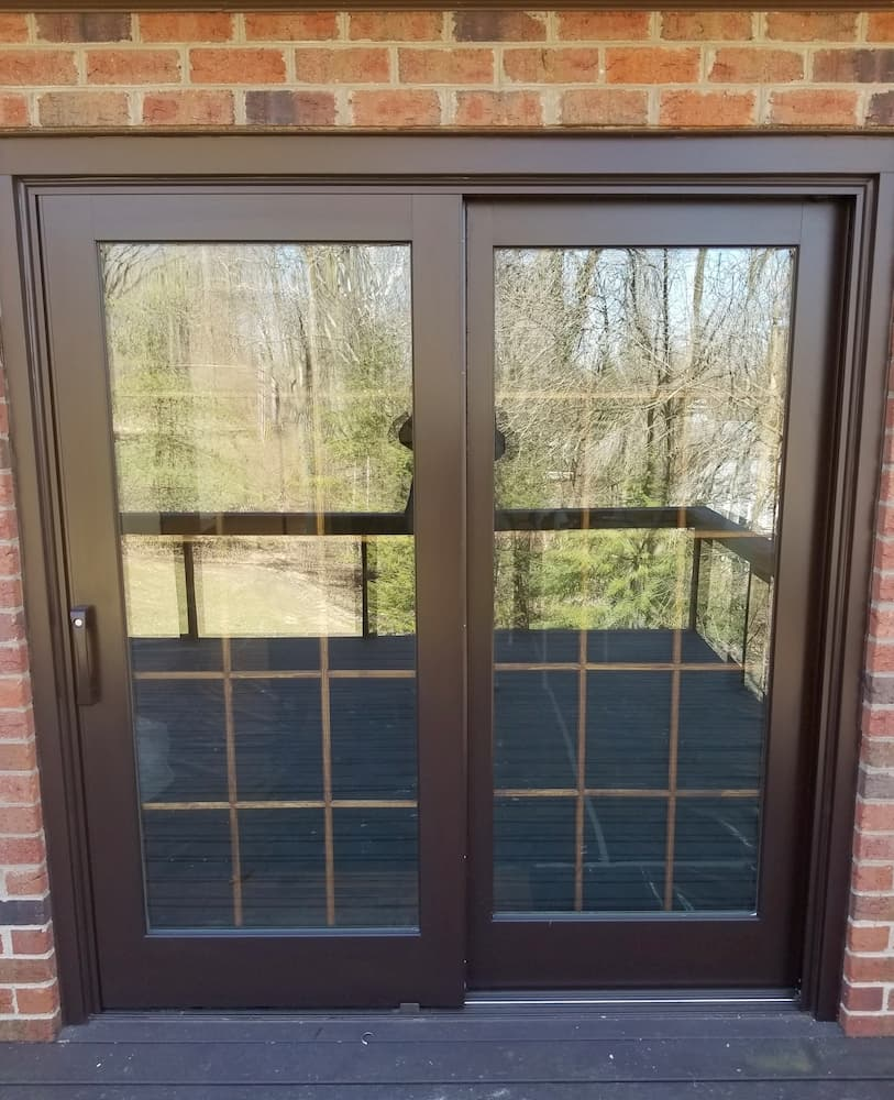 New wood sliding glass door with traditional grille pattern