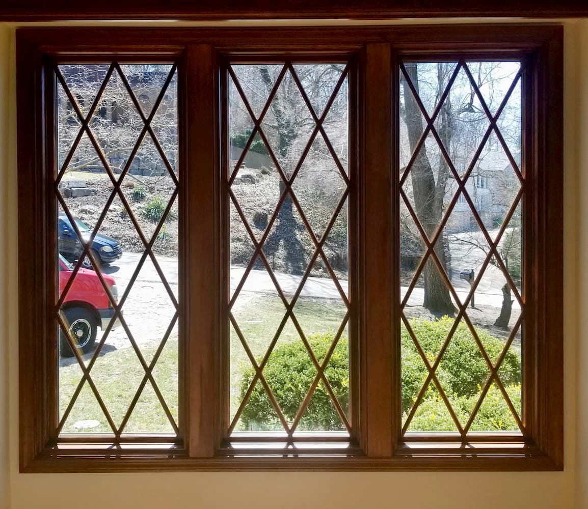 Interior view of new wood windows with diamond grille pattern