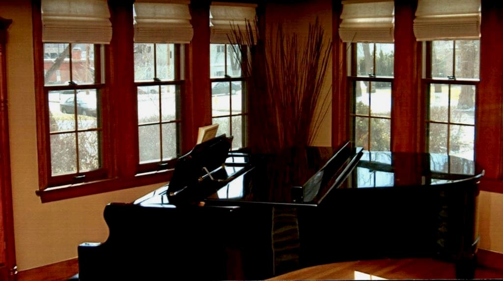 New wood double-hung windows inside a piano room
