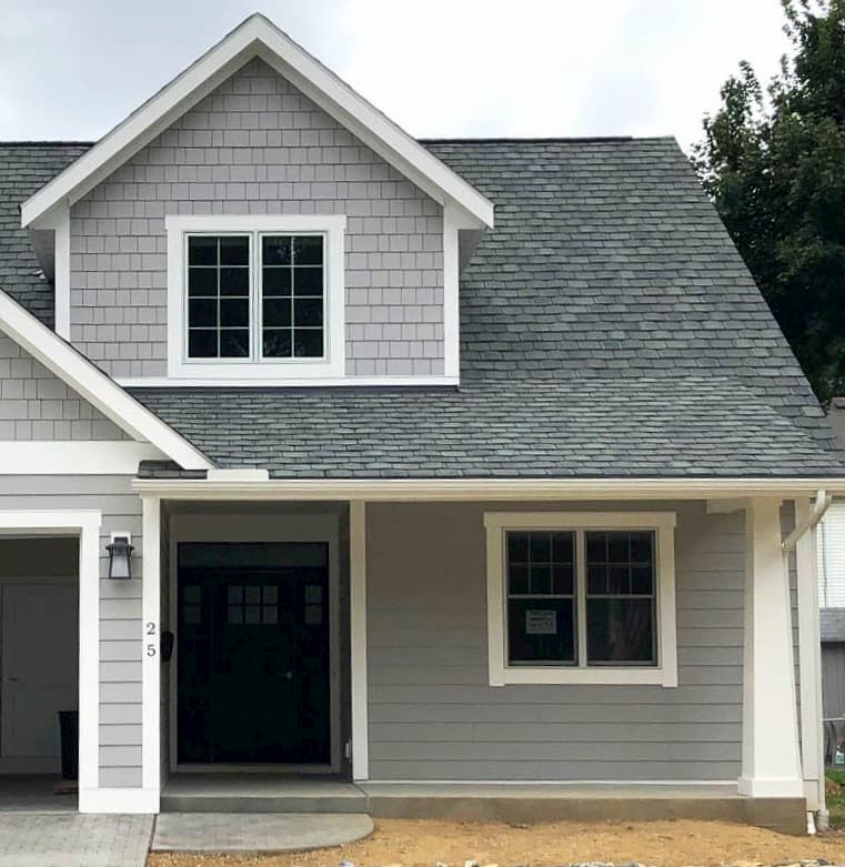 Front exterior view of new gray home with Pella wood windows