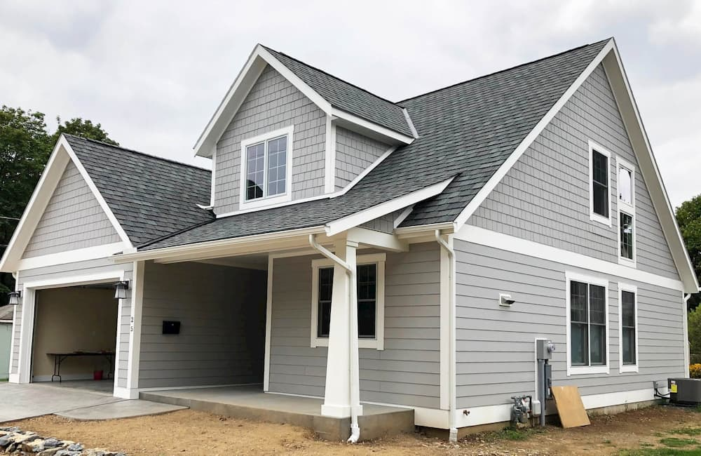 Exterior of new gray two-story home with Pella wood windows