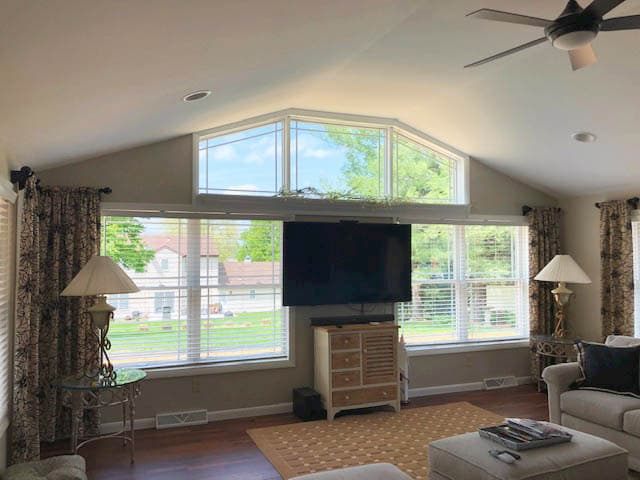 Interior view of new wood double-hung and special shape windows with prairie-style grilles.