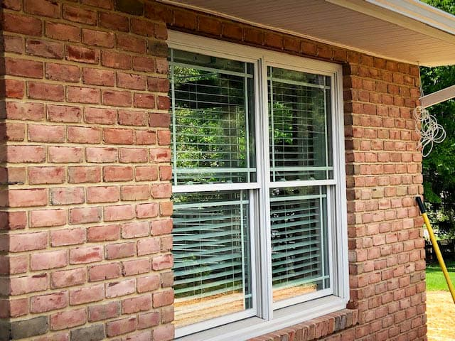 Wood double-hung windows with prairie-style grille pattern