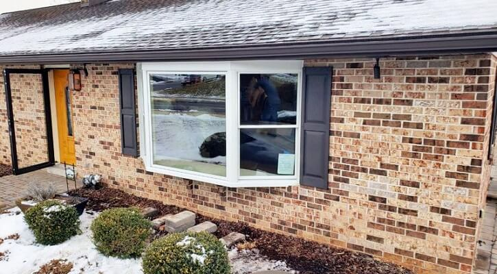 after image of denver home with new wood bay window