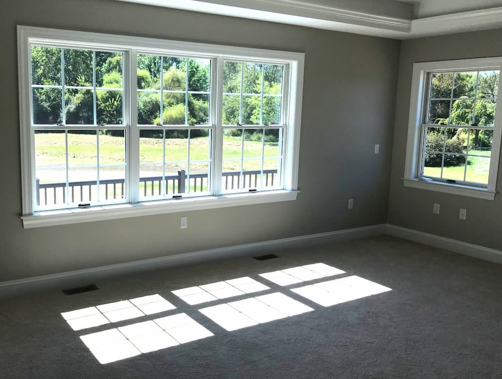 Interior view of wood double-hung windows with traditional grille pattern