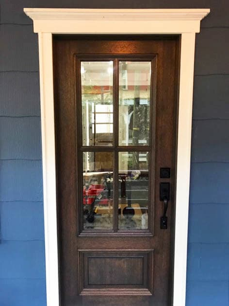 New 3/4 light wood entry door with matte black hardware