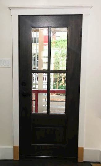 Interior view of new 3/4 light wood entry door