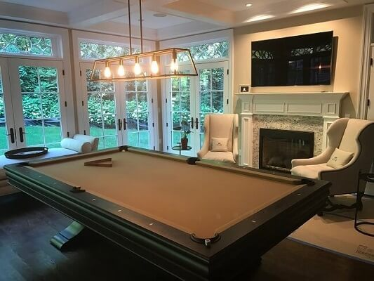 game room view of fairfield home with new hinged patio doors