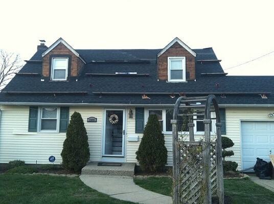 before image of hartford home with new wood windows and fiberglass entry doors
