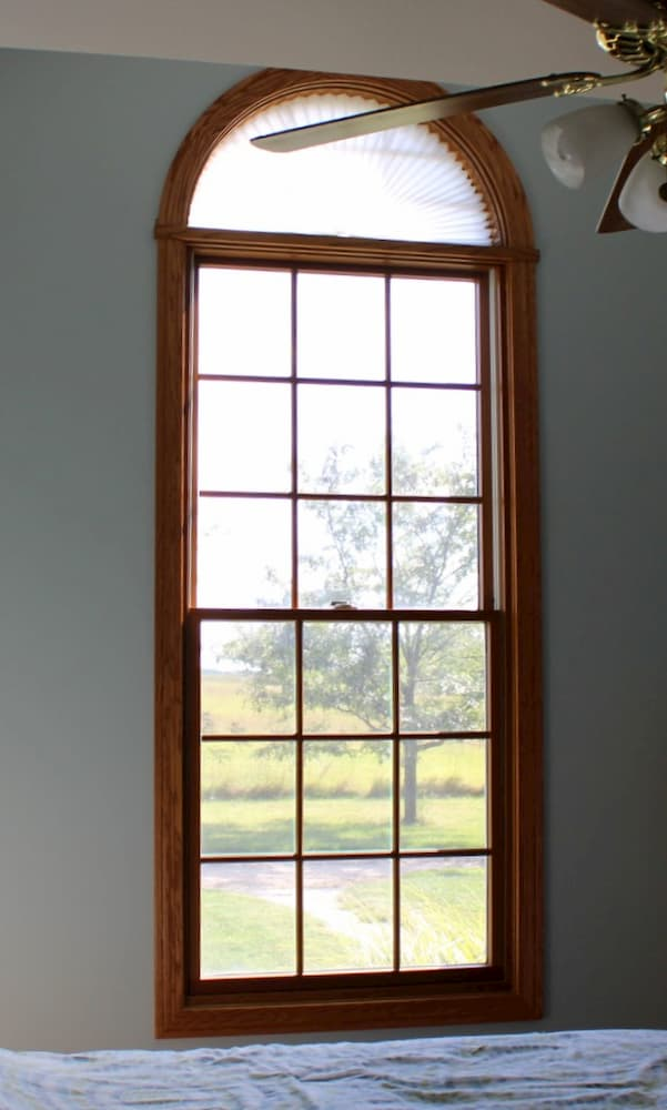Interior view of wood double-hung window with half-circle transom