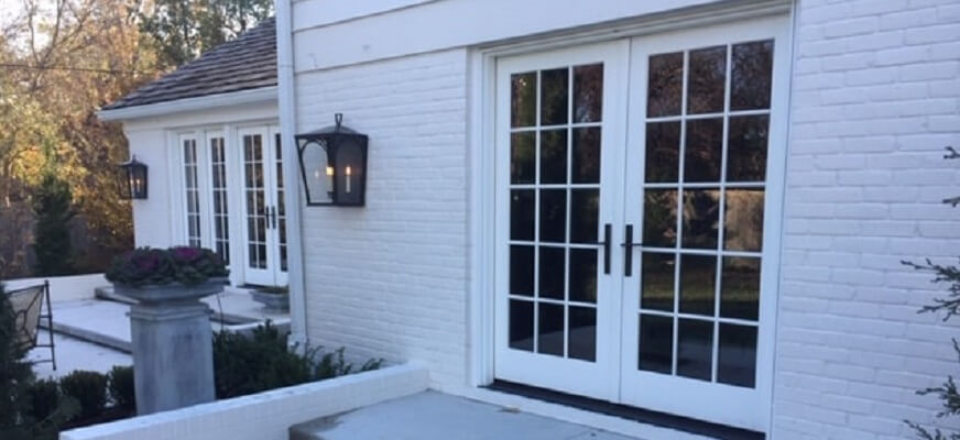 another side image of kansas home with new hinged french patio door