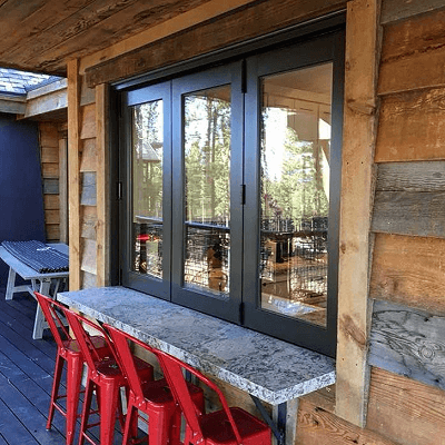 northern california home with custom mini bifold patio doors used as pass through window