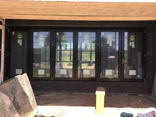 northern california new construction with bifold patio door and wood casement windows