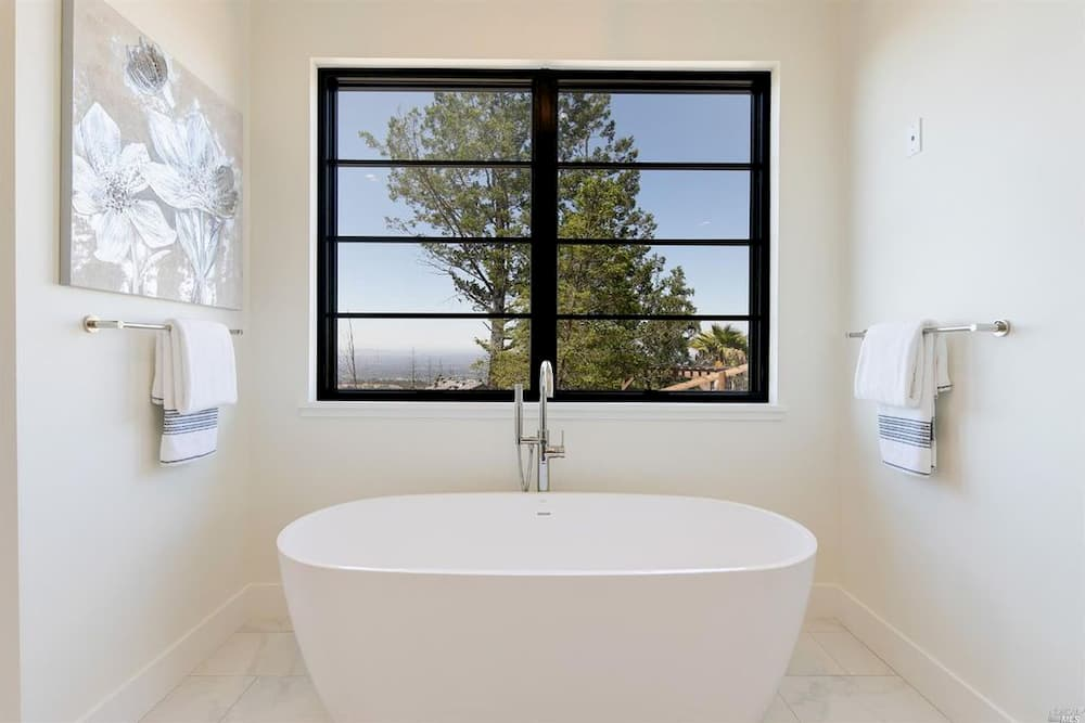 Bathroom with contemporary wood window with square grille profile