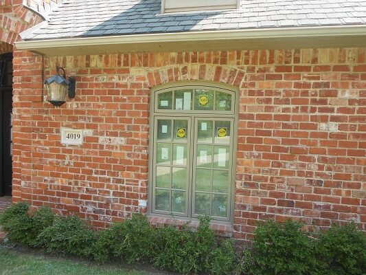 wood casement window with arch on 1995 Tulsa home