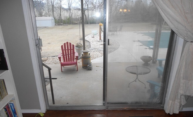 interior of old aluminum sliding patio door