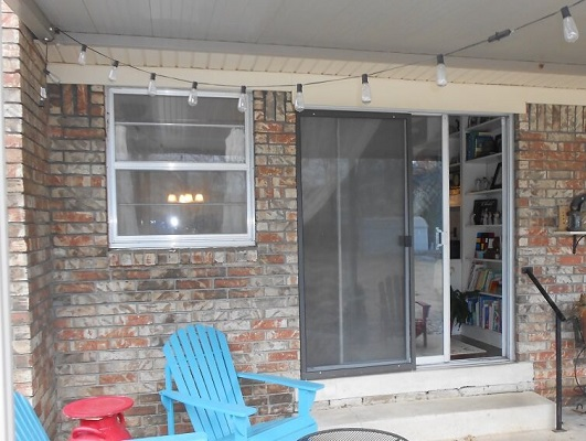 old aluminum sliding patio door on tulsa home