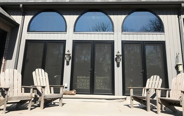 exterior view of new hinged patio doors with replacement transoms