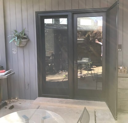 exterior of contemporary black hinged patio door