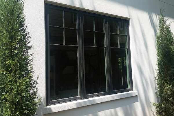 wood windows on exterior wit black aluminum cladding