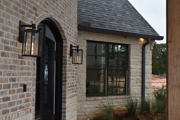 front door view of edmond ok new construction with new wood double hung windows