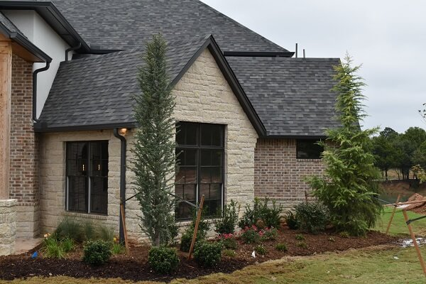 another side view of edmond ok new construction with wood double hung windows