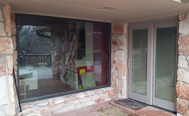 large fixed fiberglass window and sliding patio door