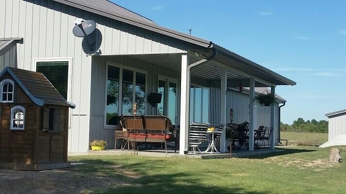 back patio on Oklahoma farmhouse with sliding patio doors
