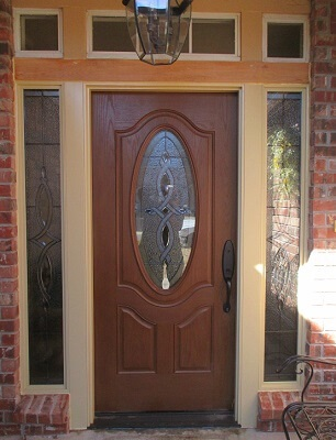new fiberglass entry door with decorative sidelights