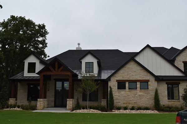 front image of new construction edmond ok home with wood casement windows