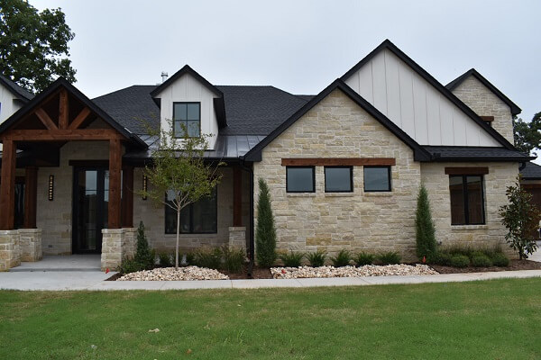 close front image of edmond ok new construction home with wood casement windows