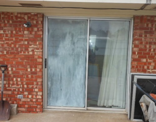 old aluminum sliding patio door