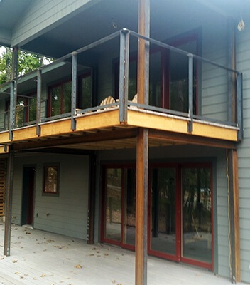 exterior two level deck with red sliding patio doors