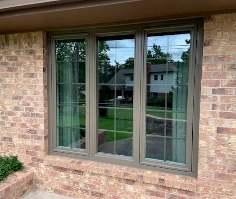 Three new vinyl casement windows with traditional grille patterns