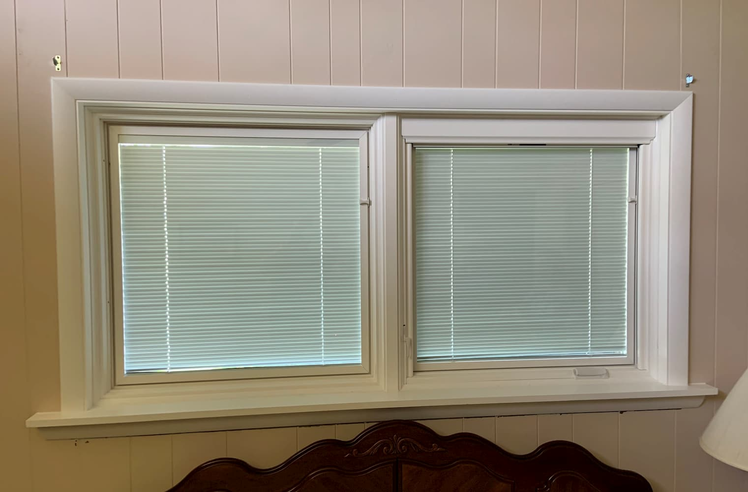 Interview view of two new casement windows with between-the-glass blinds