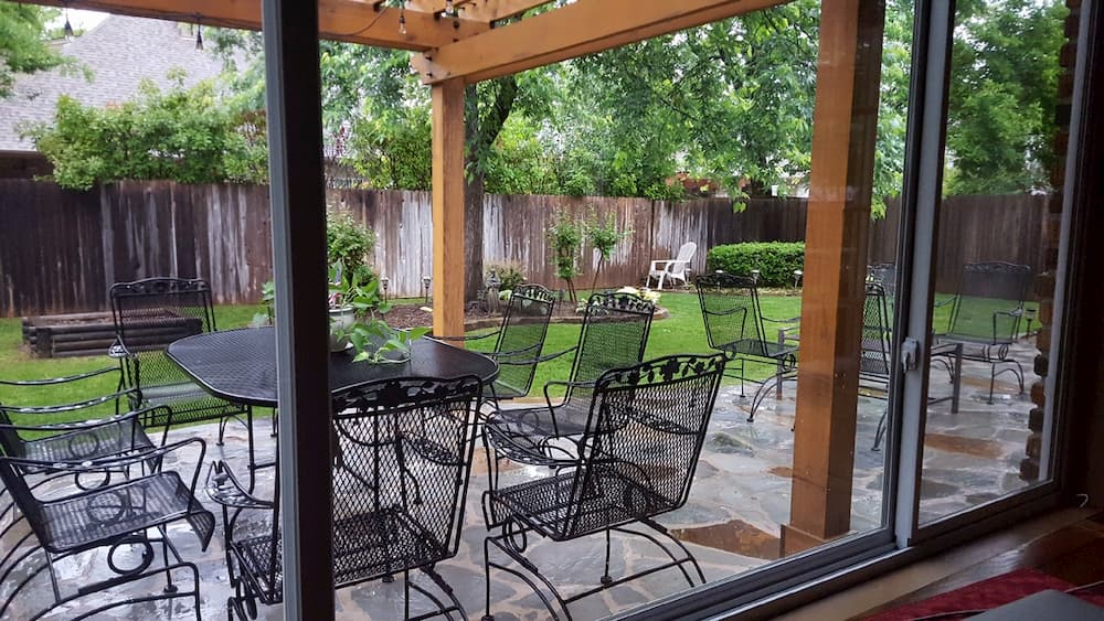 New fiberglass sliding windows provide uninterrupted view to back patio
