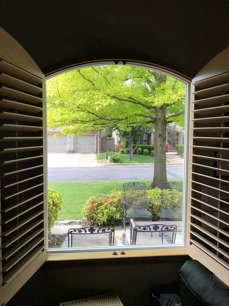 Looking out of new fiberglass special shape picture window onto patio and front yard