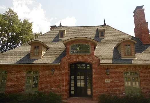 front view of wood casement windows on 1995 Tulsa home