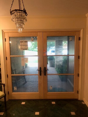 inside after image of tulsa home with new wood patio doors in front entry