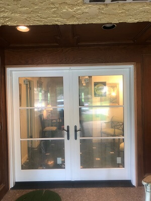 after image of tulsa home with new wood patio doors in front entry