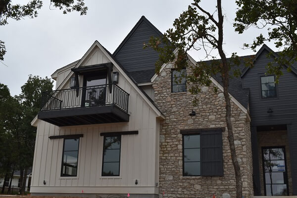 front view of edmond ok new construction home with wood casement windows