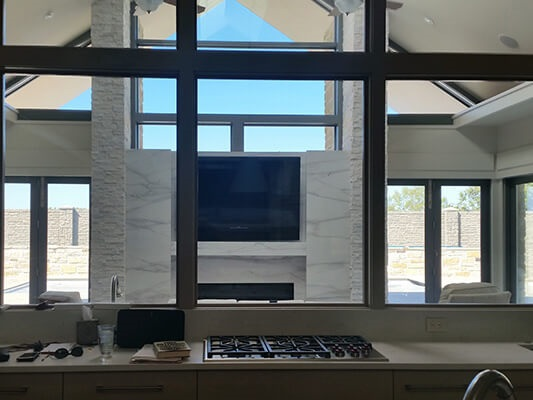 interior of Tulsa home with wood windows and bifold patio doors