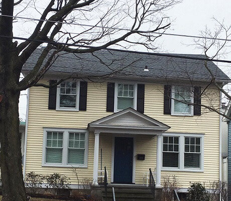 after image of princeton home with new wood double hung windows