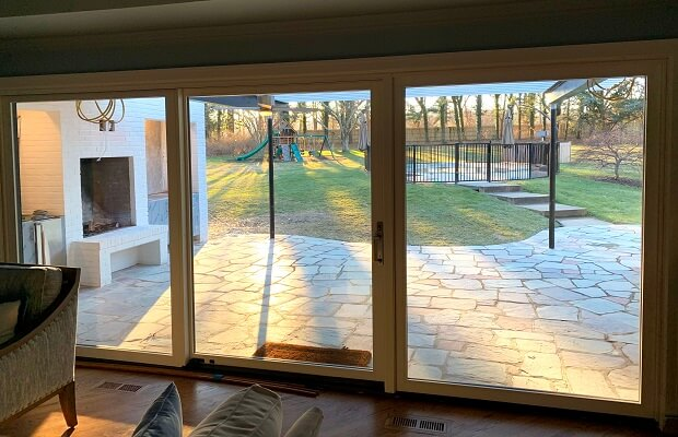 inside image of wilmington home with new 3 panel sliding patio door