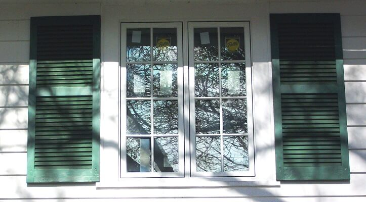 upper window image of allenstown home with new wood casement windows